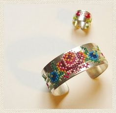 unique work of Jeweller Caro Baertling who embroiders on silver...wonderful rings, earrings, and bracelets