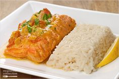 Salmon fillets simmered in an Indian-style sauce made with coconut milk, fresh ginger, spices and tomatoes and served with steamed rice make for an easy, flavorful dinner.
