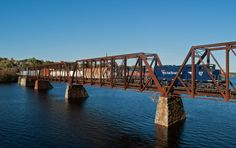 NMBK 517 Crosses Into Brewer.  Pan Am's NMBK w/ MEC 517 - MEC 321 slowly heads over the bridge connecting Bangor and Brewer (Maine) - crossing the Penobscot River on a nice October afternoon.