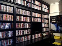From simple shelves to bookcases and beyond, discover the top 40 best DVD storage ideas. Explore cool and unique organized movie collection designs. At Home Movie Theater, Home Theater Rooms, Cinema Room, Theatre, Video Game Storage, Movie Storage, Dvd Storage Solutions, Storage Ideas, Tiny Houses