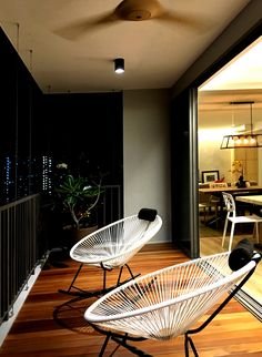 RSDS Architects -  Singapore interior design renovation - apartment balcony space with balau timber decking and rocking seats