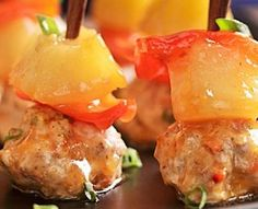 Sweet-&-Sour Meatballs These bite-size sweet-and-sour meatballs, drizzled with a pineapple- and soy-based sauce, make a great appetizer. Shredded carrot and finely diced pineapple keep the meatballs moist, while fresh ginger and Chinese five-spice powder amp up the flavor.