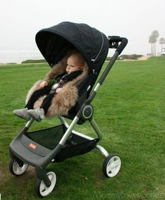 Cozy King of the Road in his Stokke Scoot with sheepskin lining via Mommy Loves Coffee
