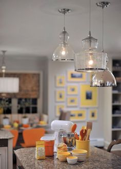 Harloe Interiors - Interior Designer - Rockville Centre - Eclectic - Transitional - Glass Lights - Dangling Lights - Yellow - Orange - Neutrals - Marble Countertop - Baking Supplies - Art - Frame - Display - Gallery - Bookshelves - Shelf - Window - Table - Kitchen