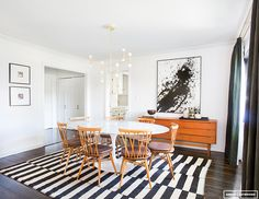mid century modern dining room with black and white rug, gold sputnik chandelier, white walls and white and black art Dining Nook, Dining Room Design, Dining Room Table, Mid Century Modern Dining Room, Antique Dining Tables, Amber Interiors, Home Fashion, Interior Design, Cafe Interior