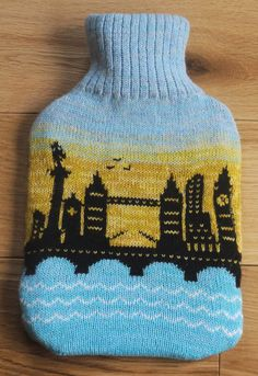 Knitted hot water bottle cover with London by LindaAnnBingham