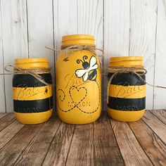 Set of 3 hand painted black and yellow Bumble Bee Mason jars. These hand painted jars are perfect for your shabby chic decor, farmhouse or rustic office decor. Painted only on the outside. Jars are hand painted, distressed, and sealed with a clear matte finish to protect against
