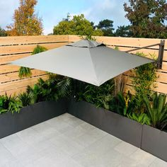 The parasol isperfect for outdoor lounge sets or other garden furniture that will not support a parasol pole & it conveniently opens above your garden furniture, shading you from the sun whilst saving space with no base or pole to get in the wa Grey Garden Furniture, Cantilever Patio Umbrella, Summer House Garden, Corner Garden, Small Backyard Landscaping, Small Garden Design, Garden Seating, Garden Spaces, Outdoor Gardens