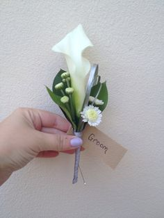 The grooms calla, bear grass, ruscus and stallion buttonhole, simple and chic