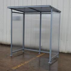 Prefabricated & Custom Built Outdoor Bus & Prefab Smokers Shelters & Sheds Shelters feature rugged welded steel construction for strength and durability. Side panels are constructed of clear tempered glass. The top is made from clear polycarbonate sheet. Mounting plates include concrete lags for installation. Ships knock down, assembly required.
