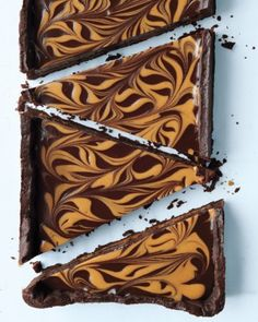 Satisfy your mom's (and everyone else's) sweet tooth on her special day. Treat her to one-- or more-- of these special desserts.The key to the marvelously marbleized look of this chocolate-peanut butter tart: a wooden skewer, which is used to swirl warm peanut butter atop chocolate ganache.