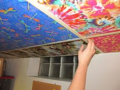 Basement ceiling ideas include paint, paneling, drop ceilings, and even fabric. even if you only need to cover ductwork at one part of your ceiling, Drop Ceiling Tiles, Fabric Ceiling, Ceiling Art, Dropped Ceiling, Ceiling Panels, Ceiling Ideas, Ceiling Tiles Painted, Acoustic Ceiling Tiles, Basement Ceiling Options
