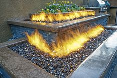 Hiner Landscapes designed this custom Fire Feature with Warming Trends Custom Crossfire Burners and pans.