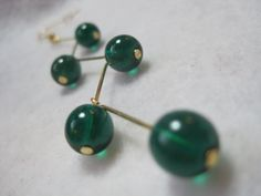***Please do not pin this just to use as a pattern. Please respect my copyright and work.*** Green dangling earrings. Cascading design. Deep by ArtsParadis, $11.00