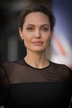 Stunning: Angelina looked sophisticated as she arrived at the event...