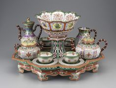 "The Sèvres tea and coffee service recently acquired by the Detroit Institute of Arts, and featured here, is extraordinary in style, design, fabrication, and decoration. The service is comprised of fourteen pieces: a footed tray (porte jatte), coffeepot, teapot, covered sugar bowl, milk pitcher, waste bowl (on the center pedestal), and four cups and saucers. A breakfast set, it is referred to as a ""déjeuner Chinois Réticulé"" and is said to have been inspired by a set of Chinese porcelain that…"