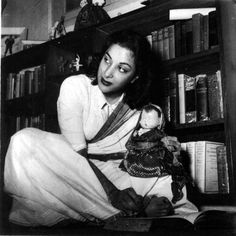 Dolls and books, books, books. There is a copy of 'Great Lives' and another of the short stories of H.G. Wells. This was a woman not indifferent to the world at large. Also note the joker statue and the photograph at the back. Is that Raj Kapoor?