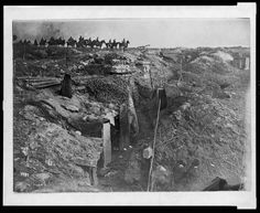 Abandoned British trench which was captured by German forces during World War I. German soldiers on horseback view the scene.