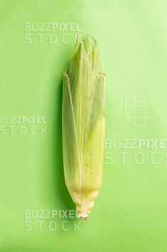 Royalty Free (RF) Photos / Vectors / Ready Made Logos / by BuzzPixelStock Ripe corn in the leaves on a green background Photography For Sale, Green Backgrounds, Leaves, Stock Photos, Vegetables, Vegetable Recipes, Veggies