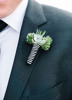 The groom's boutonniere pairs tiny succulent with greens. Brklyn View Photography