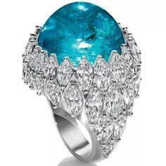 Harry Winston one-of-a-kind cabochon Paraiba tourmaline and diamond ring.