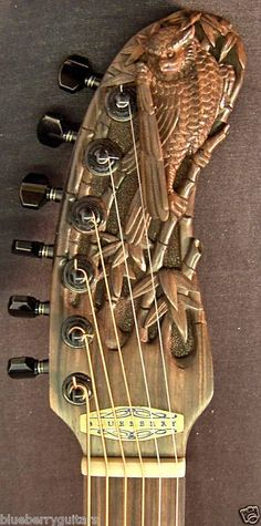 Beautifully Carved wooden guitar headstock.  -cSw:) - http://www.pinterest.com/claxtonw/ - Pin via #DdO:) MOST POPULAR RE-PINS  http://www.pinterest.com/DianaDeeOsborne/instruments-for-joy - INSTRUMENTS FOR JOY. A touch of Roman Imperial History look in this BLUEBERRY model brass gold colored CURVED headstock. Unusual shape electric guitar headstock, that features a hawk, falcon or similar bird with fascinating unique detail. Dark tuning pegs add to rich luxury look. Photo source Premier Guitar.