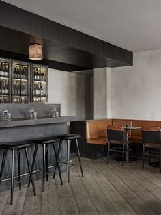 Soft brown leather seats and a grey-toned iron bar feature inside this seafood restaurant overlooking Copenhagen's Torvehallerne food market.