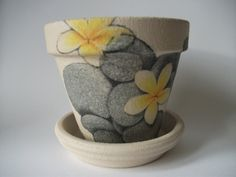 Flower Pot decorated with Grey pebbles & Yellow Flowers £9.00