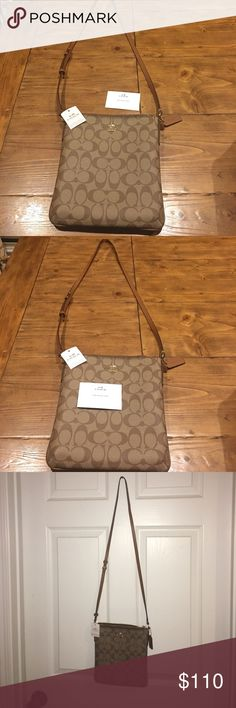 Coach Women's Crossgrain Leather Crossbody Bag Leather crossgrain Coach purse. Slender, cross body bag never carried, tags still on purse. Adjustable strap for a comfortable hands free carry. Leather, zip top closure. Outer side pocket on backside with snap closure. Inside pocket, as well. Coach Bags Crossbody Bags