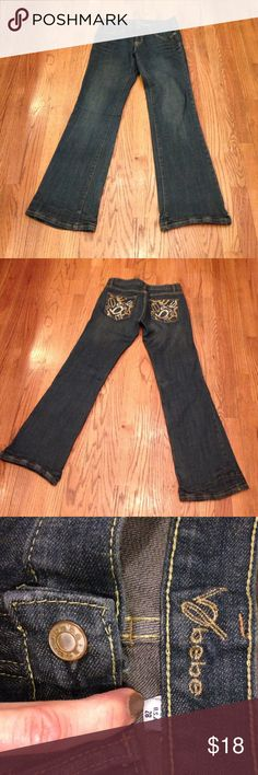 "Bebe Jeans Flair leg jeans w/ rhinestone ""bebe"" logo design on back pockets. In good used condition. bebe Jeans Flare & Wide Leg"