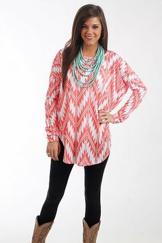 """Desert Diva Tunic, Coral $37.00  You DO NOT want to miss this tunic! This super soft top has jagged chevron stripes in white on coral, and we love the long length and dolman sleeves! Throw it on over leggings or skinny jeans for an outfit that's unbeatably comfy and cute, too!   Fits true to size. Miranda is wearing a small.   From shoulder to hem:  Small - 30.5""""  Medium - 32""""  Large - 33.5"""""""