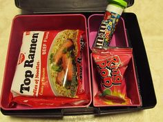 "April fools day lunch. All the packs of ""junky"" foods are filled with goodness (sandwich in ramen, M&M = cherry tomatoes)"
