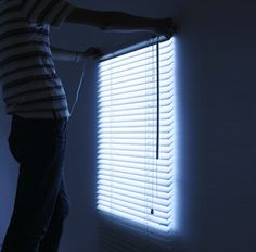 No windows in your home or office? These light up blinds may make you feel less like a prisoner.