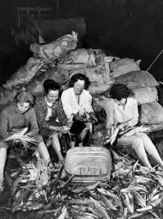 Women shuck corn at a Detroit Police picnic in 1963