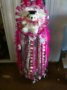 Custom made senior homecoming mum with a hot pink accent! $215
