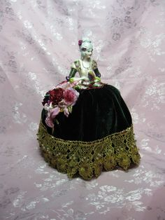 Porcelain Half Doll Boudoir Doll Pincushion Doll Dresser doll dressed IN green and gold with pink and burgundy flowers.  Stunning   NEW