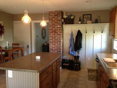Exceptional Exposed Chimney And Custom Coat Hanger Wall. #renovation #island #brick # Wainscoting