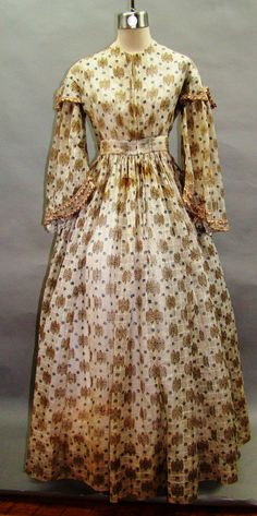 """All The Pretty Dresses: Mid 1860's Sheer Dress Light & airy sheer dress. Pagoda sleeves have little notched sleeve caps & trimmed in silk floral & fringed ribbon. Ribbon incredibly detailed for it's size - only 1/2"""" wide, not counting the fringe at the bottom. Bodice entirely lined wt muslin & darts boned wt what appears to be baleen. Fabric is printed windowpane light muslin. Sleeves still have undersleeves attached at shoulders. Bodice closes wt hooks & eyes. Approx 31"""" B, 25"""" W, skirt L…"""