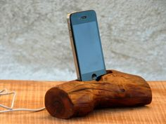 Beautiful tree branch iPhone station. Handmade from gorgeous almond wood. The stand fit to iPhone 4, iPhone 5 and phones with similar sizes. Being hand-made, each item is one of a kind.  Size approximately: Length: 17 cm (6,63 in.) Width: 7 cm (2.73 in.) Height: 4.5 cm (1.75 in.)