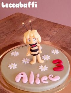 Maia the bee cake topper