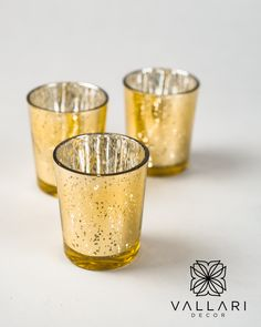 """Beautiful gold glass votive glass candle holders. Great for small floral arrangements, tealight or votive candles. Please note that each piece is unique so the """"speckled"""" design may vary slightly with each candle holder. These make the perfect addition to any vintage or elegant wedding! ✨Follow us on social media!✨ 👉Instagram - @VallariDecor 👉Pinterest - @VallariDecor 👉Facebook - @VallariDecor Votive Holder, Glass Candle Holders, Glass Votive, Votive Candles, Diy Centerpieces, Gold Glass, Mercury Glass, Winter Christmas, Elegant Wedding"""