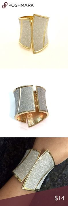 Sparkly Cuff Bracelet This sparkly cuff bracelet in sparkly white and yellow gold is just perfect to jazz up an outfit. The angles are so stylish! Worn twice. In very good condition. All pictures are of the actual bracelet. Reasonable offers always welcomed :) Jewelry Bracelets