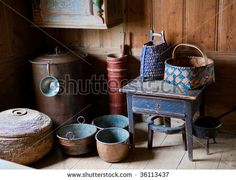 Old fashioned pots, pans and baskets of the 18th century in Skansen, Stockholm, Sweden - stock photo