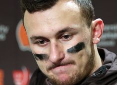 FILE - In this Dec. 20, 2015, file photo, Cleveland Browns quarterback Johnny Manziel speaks with media members following the team's 30-13 loss to the Seattle Seahawks in an NFL football game in Seattle. Former Cleveland Browns quarterback Johnny Manziel was indicted by a grand jury on Tuesday, April 26, 2016, on misdemeanor charges stemming from a domestic violence complaint by his ex-girlfriend. (AP Photo/Scott Eklund, File)