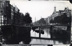 1940's. View on the Keizersgracht in Amsterdam. On the right De Zaaier church. The Keizersgracht is the middle one of the three main Amsterdam canals: Keizersgracht, Pinsengracht and Herengracht. With a width of 31 metres it is the widest canal in the town. It was constructed in 1612 at the same time as the Herengracht and Prinsengracht. De Zaaier was built in 1833 for the RK Ignatiuskerk. Today the church is used as an art exhibition center. Photo Spaarnestad. #amsterdam #1940…