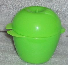 "Tupperware Apple Keeper Locker for Lunch & More by Tupperware. $3.75. Hinged one-piece construction, Green in color. Tupperware Forget Me Not Apple Keeper Fruit Locker. Dishwasher safe. Ideal for taking to school or work, camping, or traveling, protects fruit. 1 Tupperware Apple Locker. Ideal for transporting fruit to work or school. Green in color. Unique apple shaped storage container. Measures approx 4 1/4"" x 4"". Hinged one-piece construction. Dishwasher safe"