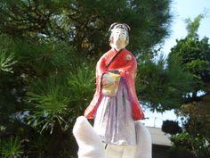 Japanese antique clay doll a woman beautiful kimono wore bring something #hanamaki