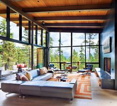 A Modern Nest in the Forest of Whitefish, Montana, contemporary modern, home design in mountains, mountain living architecture, outdoor living, living room