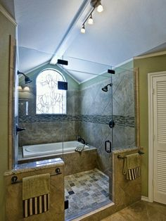Bath in shower, double shower head bathroom. oh my. love the idea, but get rid of the window