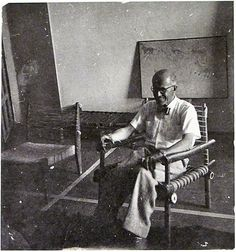 Pierre Jeanneret, In a bamboo chair of his own design. Painting behind him by his cook Bansi Lal. 1955